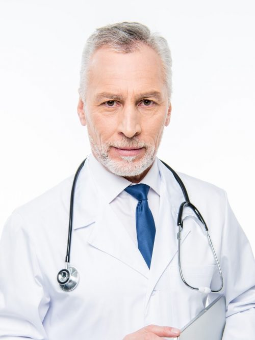 smiling-mature-male-doctor-with-stethoscope-holding-laptop-isolated-on-white-e1625182645470.jpg